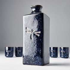 Dark blue sake set with dragonfly on the front - 1 bottle, 4 cups - Made In Japan Europe Japanese Drinks, Blue Dragonfly, Flask, Barware, Dark Blue, Bottle, Cups, Europe, Design