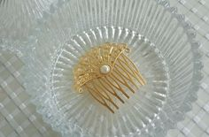 Hair Accessories - Gold Hair Comb - Bridal Hair Comb - Bridal Hair Accessories - Wedding Hair Jewelry - Rhinestone Hair Jewelry  This lovely romantic gold plated hair comb is beautiful addition to your wedding day! it is made of 24K gold plated brass, and it is set with a artificial pearl in the center.  Perfect for romantic brides or any special occasion you want to be chic and special.  $32.00