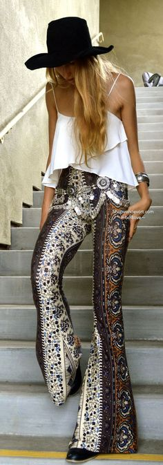 Flared 70's pants woth a layered white top
