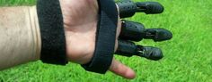 Howard Kamarata and Casey Barrett built a prosthetic hand using a 3D printer and parts from Home Depot. (Yahoo News)
