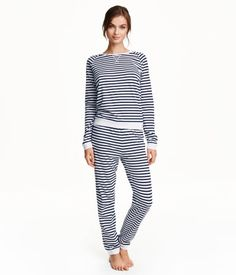 Pajamas in soft patterned jersey. Top with long raglan sleeves, ribbed cuffs, and gently rounded, ribbed hem. Pants with an elasticized drawstring waistband and wide, gently tapered legs with ribbed hems.