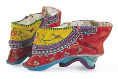 """Perhaps no other shoe in history has provided so much cultural fascination and ethical revulsion than the traditional Chinese practice of foot binding. Undertaken by (or enacted upon) young girls between the ages of 5 and 7, the binding process entails the breaking of the bones in the foot, and subsequent warping and (sometime) mutilation of the foot in order for it to remain a tiny size, ideally no longer than three inches in length (known as a """"golden lily"""" by practitioners)."""