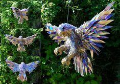 Broken CDs Transformed Into Iridescent Animal Sculptures | The Creators Project   http://thecreatorsproject.com/blog/broken-cds-transformed-into-iridescent-animal-sculptures/#