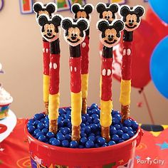 Create a super-cute treat that's super-easy! All you need is Candy Melts & Mickey Mouse sugar decorations!