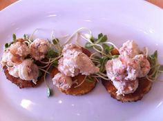 Fried Green Tomatoes appetizer with topped with Florida rock shrimp and local sunflower sprouts at Public House Chatt