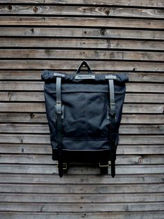 Black waxed canvas backpack with roll to close by treesizeverse