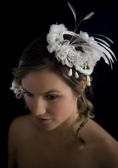 Feather and pearl fascinator.  #wedding #fascinator