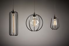 """""""Farrier's Cage Collection"""", designed by Anthony Dickens and made by Richard Fishenden. It consists of a trio of wrought iron 'lampshades', designed to suspend from the ceiling; one 'teardrop', one 'long' and one 'round'."""