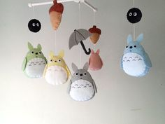 ((( INCLUDES )))  This nursery mobile contains 5 Totoros,1 umbrella, 2 acorns and 2 Dust bunnies. They are suspended from a white wood hanger, about 13