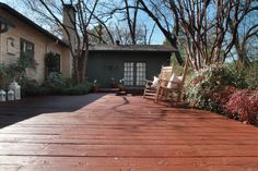 """Lanterns, rockers, potted flowers and a new coat of deck stain make the perfect """"deck""""cessories!"""