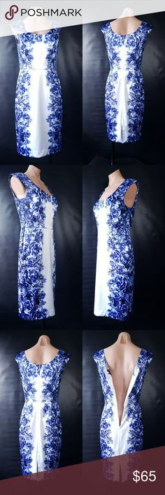 Midi Floral Bodycon dress Classy midi bodycon white dress with blue floral pattern from White House Black Market . Worn once. Drycleaned.  Perfect fit with semi stretch. Size 6, will fit ok  slightly bigger. Zipper.  Length (from neck to bottom(not from the dress back cut))-41 in. White House Black Market Dresses Midi