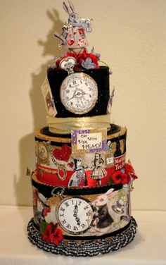 "An incredibly fun centerpiece for adult or child party. ""Alice in Wonderland"" can also be made into a Wedding Card Reception Box. Detailed, sparkly creation from the black top hat on top to all the crazy clocks, red flowers against an aged, then white washed, newspaper. Your guests will love it! CUSTOM ORDERS TOO!!  #Centerpieces  #Weddingcardboxes"