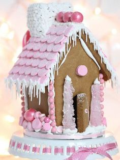 Of all our favorite kitchen-crafty holiday projects, decorating a gingerbread house is second only to baking (and eating!) Christmas cookies. But skip the same old red and green gumdrops this year and check out these adorable (and original) gingerbread house tips. Holiday cheer? We think so!Minimalist DecoratingTania McCartneyForget covering your gingerbread house in mounds of candy. Instead, add