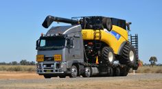 truckingworldwide:  Volvo heavy haul with New Holland combine