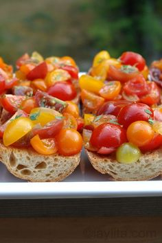 Tomato bruschetta topped with feta and olive oil!