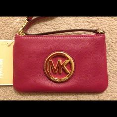 """NWT Michael Kors Fulton Leather Purse/Wrislet NWT Michael Kors Fulton Leather purse/wristlet- beautiful pink/fushia color.  Has the medal hardware MK logo on the front of the purse.  Measures 7"""" in length & 4 1/2"""" in height Michael Kors Bags"""