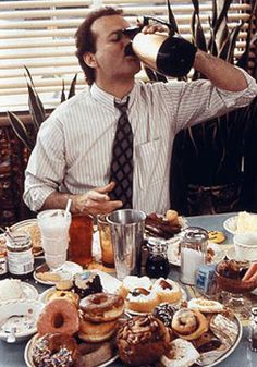 Bill Murray drinking coffee.  BEST scene from Groundhog Day-- this and eating the entire slice of cake in one bite still cracks me up.