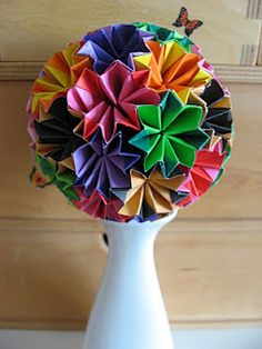 Kusudama are SO easy to make...and given the right vase underneath (maybe filled with glittered paper or stones), they would make great centerpieces