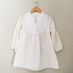 Feminine Cotton Top Feminine Cotton Top Such a lovely blouse with no flaws! Size S Gently Worn 100% Cotton  ✗No paypal, No trade ✗I don't sell on any other site ✔I do accept reasonable offers ✔️Items will be shipped within 1-2 business days Bundle 2+ items to get 10% off! Tops Blouses