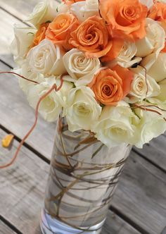 DIY Flower Arrangement from Party Box Design Blog.  How to create a flower arrangement with sticks & rose stems wrapped around the inside of the vase.  For a rustic yet chic feel.