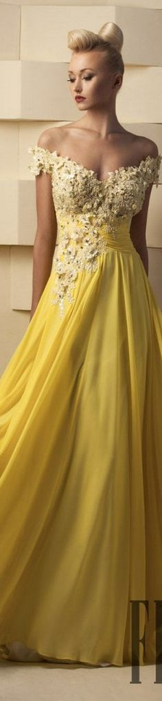 Off the shoulder evening gown with flower beaded bodice. The yellow dress features an empire waist line and flowing chiffon skirt. The open neck line is flattering for most frames. You can use this as a colored wedding dress or for a formal occasion. We can create couture looks like this for you at a reasonable cost. We offer replicas as well as custom evening dresses for all sizes. www.dariusfashions.com