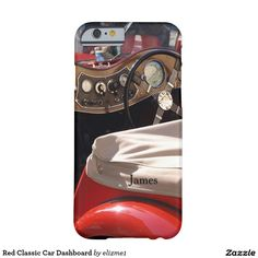 """Red Classic Car Dashboard Barely There iPhone 6 Case A photo of a gorgeous red classic car from the last century, taken from the back looking toward the dashboard, showing the instrument panel and the steering wheel. A beautiful building is reflected in the vintage auto's speedometer. The case can be personalized with your name or text by clicking on """"Customize it""""."""