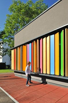 Kindergarten Kekec / Arhitektura Jure Kotnik (rotating vertical shutters create colourful and interactive exterior)