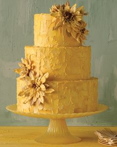 Inspired by van Gogh's famous painting, the floral motif on this cake will brighten any reception—from the eclectic to the more traditional in style. A golden color palette (both inside and out) and oven-dried piped meringue petals channel van Gogh's cheerful blossoms. To mimic his textured brush strokes, buttercream frosting was painted on with a brush.