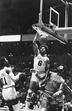 Dr. J dunking over 7 Foot 2 inch center Artis Gilmore who is also in the Hall Of Fame.