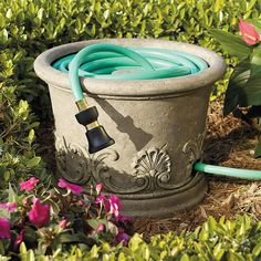 Get your garden ready with plenty of hoses to choose from, nozzles, garden storage and decorative hose storage pots and hose reel holders. Garden Hose Storage, Patio Storage, Outdoor Storage, Water Hose Holder, Garden Hose Holder, Garden Projects, Garden Tools, Hose Reel, Lawn And Garden