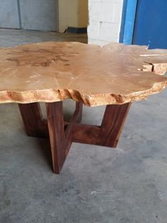 This beautiful coffee table was made with a slice of a maple tree. The two-inch-thick slab is set atop a walnut base which is slightly angled to make the top appear as if it is a crown. The slab was flattened and the bark stripped off the edges, and then finished with oil and beeswax to bring out the beautiful figure of the grain. This table measures approximately 36 in diameter and is 18 high. I can customize bases (of wood or metal) to fit your decor, and pricing depends on the size and…