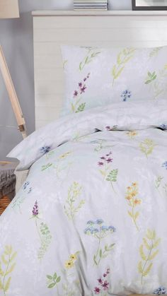 Bring a touch of spring to your home all year round with this pretty spring garden inspired printed duvet set. Soft watercolour flowers are arranged across the duvet set, in soft yellow, purple and blue tones finished with delicate green stems and leaves. The reverse features a subtle floral pattern in soft grey tones.