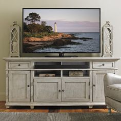 "Features:  -Oyster Bay collection.  Distressed: -Yes.  TV Size Accommodated: -75"".  Product Type: -TV Stand.  Design: -Cabinet.  Finish: -Oyster Shell.  Frame Material: -Wood.  Cabinets Included: -Yes"