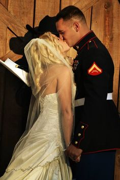 Credit to: Mandi B Photography first kiss barn wedding outdoor ceremony country marine wedding military wife