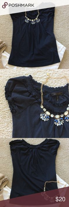 """BCBG MaxAzria navy blue top BCBG MaxAzria navy blue top. Super cute! Smocking detail around the neckline. Ruffling around the sleeves. Laying flat approx 24"""" shoulder to hem, approx 15"""" pit to pit. 100% cotton. Size S. Excellent condition. #352 BCBGMaxAzria Tops Tees - Short Sleeve"""