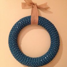 DIY Bean Wreath!  Hot glue dry navy beans (or any kind) to a foam wreath and then spray paint! Simple!