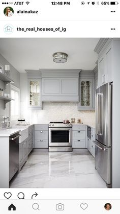 Modern Kitchen Design This gray u-shaped kitchen features a gray paneled hood flanked by antiqued mirrored kitchen cabinets and mounted against white and gray mosaic backsplash tiles over a stainless steel oven range. Grey Kitchen Cabinets, Kitchen Cabinet Design, Kitchen Tiles, New Kitchen, Kitchen Decor, Kitchen Grey, White Cabinets, White Kitchen Flooring, Kitchen With Tile Floor