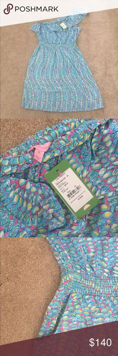 NWT Lilly Pulitzer Jessy Dress - Clam Jam XL NWT Lilly Pulitzer Jessy Dress in Clam Jam. Size XL. Adorable one shoulder ruffle with elastic waist and pockets. I bought this from another posher, but it didn't fit the way I had hoped. Lilly Pulitzer Dresses One Shoulder