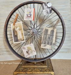 http://mysalvagedtreasures.blogspot.com/-Wheel Meets Lamp Base A rusty bicycle wheel was bolted to the heavy cast iron floor lamp base. I glued some rhinestones to the center of the wheel, added a magnetic button, then clipped on some pictures.