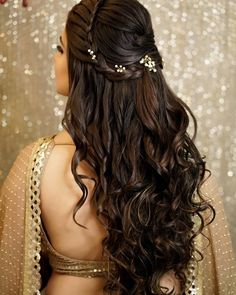A beautiful crown braid coupled with voluminous curls and some fancy hairpins can make for a glamorous half-tie hairstyle. # indian Hairstyles 27 Effortlessly Stylish Half-tie Hairstyles We Spotted on Real brides Bridal Hairstyle Indian Wedding, Bridal Hair Buns, Bridal Braids, Bridal Hairdo, Wedding Hairstyles For Long Hair, Bridal Hair And Makeup, Bun Hair, Open Hairstyles, Indian Hairstyles