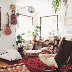A living room in the bedroom corner of Emily Katz's Portland home. #pendleton Chimayo throw!