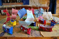 Pirate ships made with juice boxes & a pirate map craft. I love the idea of cutting up the map pieces so they have to piece them together.