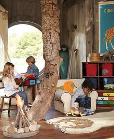 """how cool would it be to have a tree """"growing"""" through the middle of a playroom!? Wonder where you find a 9 ft fake but realistic looking tree trunk?"""