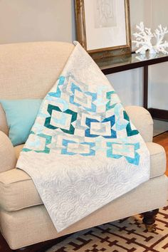 Calming colors and Flying Geese units - a great combination! Make this elegant wall hanging quilt pattern, Stones Across Water by Ellen Cicak, with an efficient, accurate and quick technique! We'll show you how!