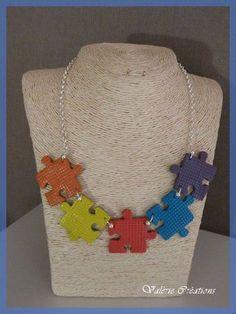 puzzle piece necklace.. [Could also decoupage paper images onto each piece]