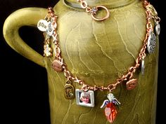 Precious Memories Charm Necklace : Artbeads.com - Learning Center---This necklace is wonderfully busy! Our designer created this with her favorite crystal colors and all different metals. Feel free to use our list of components or create your very own!