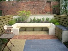 Large outdoor seating, rendered walls, slate paving, brick paving, timber decking by Paperbark Garden Design