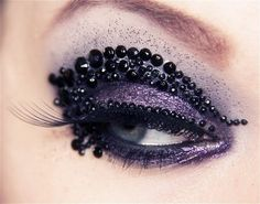 intense black jewels, purple eye shadow & long lashes