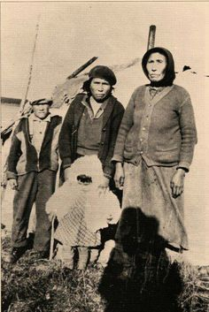 L-R: Sam Kitchen, Louise Minister with her daughter Alice, Hannah Minister near Waskaganish, Quebec - Cree - circa 1920  You can tell they worked Hard,very Hard during the Depression