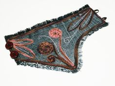 Bohemian bracelet Jeans cuff Denim boho chic textile cuff upcycled bracelet    Bohemian blue jeans cuff textile bracelet OOAK mouve and eggplant motif. Romantic and rustic-inspired.  This unique Bohemian bracelets made of denim. Decorated with a romantic theme. Asymmetric shape and pattern.  Rustic-button closure.    This is a pretty and unique textile jewelery.    Dimensions: Length 20 cm / 8 inches,  width of 7-13 cm / 2 3/4-5 inches    The last picture you see a different color bracelet…